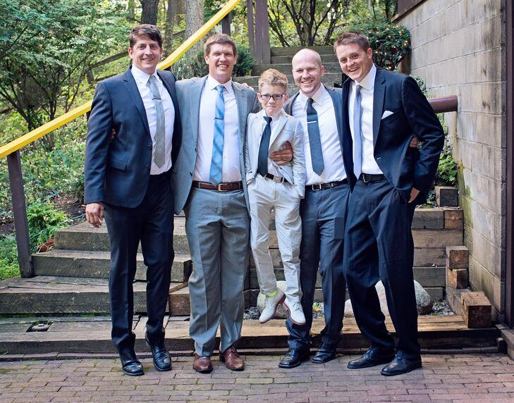 "Each of Ricky's groomsmen wore a simple suit in a shade of gray. ""We had planned on boutonnieres originally, but we really struggled to find anything that looked right,"" Natalie says. ""Rather than settle on something that we didn't really want, we went without them. I have to say, the guys looked a lot cooler without them."""