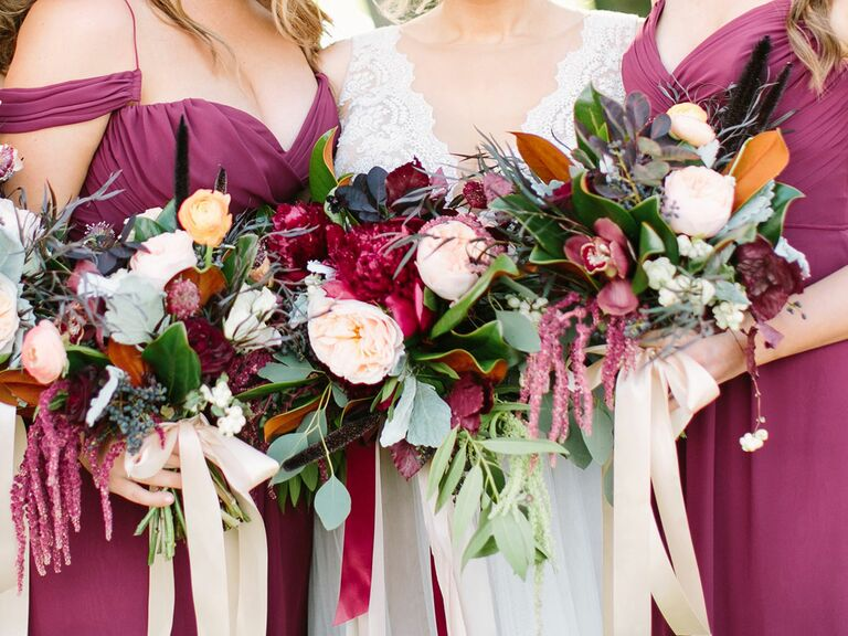 Bride and bridesmaids holding bouquets.