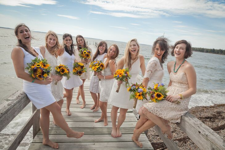 Sylvie let her bridesmaids wear their own white dresses. Bare feet made the look extra casual.
