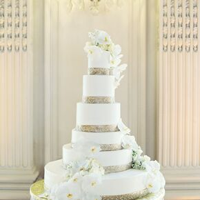 Six Tier Gold Trimmed Fondant Cake With Orchids