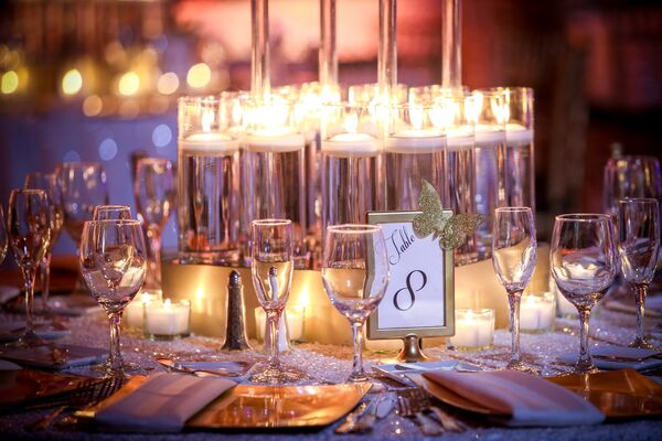 Gold and Glass Accents on Candlelit Table