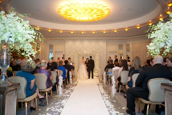 All White Indoor Wedding Ceremony Site: White Rose Bridal Bouquet