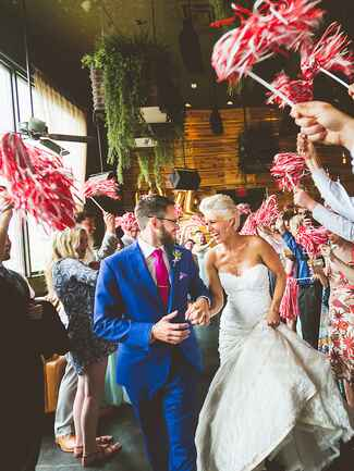 Wedding exit with red and white cheer pom poms