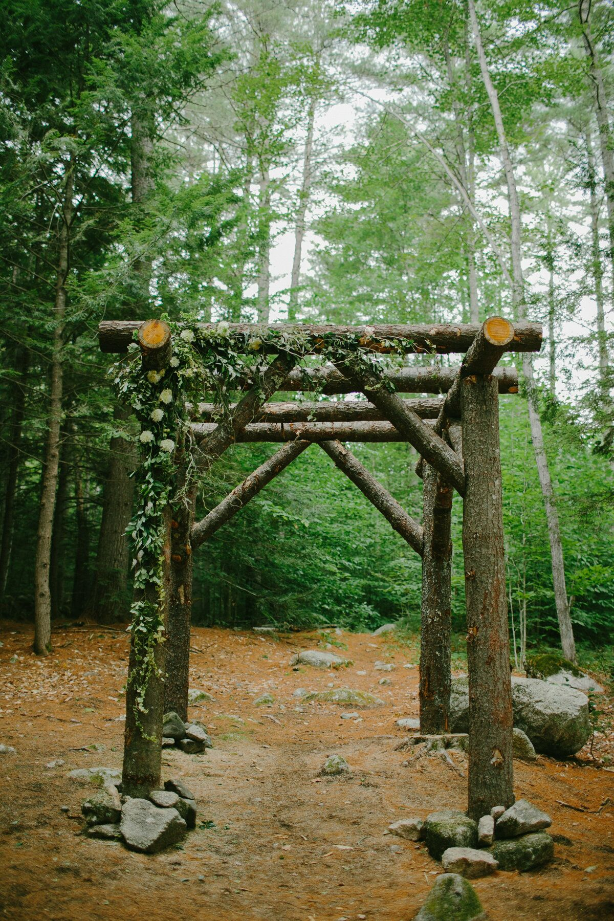 Rustic Handcrafted Tree Trunk Wedding Arbor
