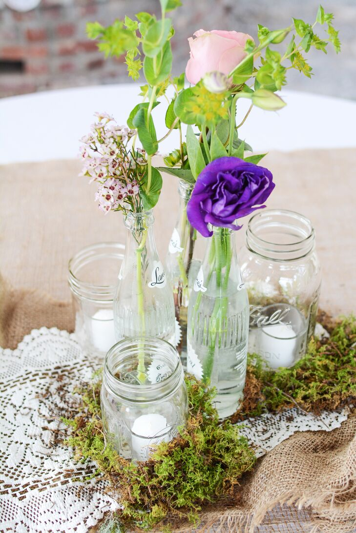 Wildflower centerpieces in glass bottles for Glass bottle centerpieces weddings