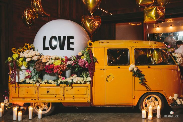 "Amy and Geoff's wedding planners brought in a vintage Volkswagon truck and filled it with flowers, candles and a giant ""Love"" balloon. ""The space was large, and we had a smaller amount of guests, so it helped keep the atmosphere cozy while creating another great place for photo ops,"" Amy says."