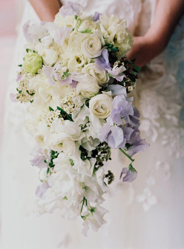 Purple wedding bouquets sweet peas with ranunculus stephanotis and tuberose mightylinksfo