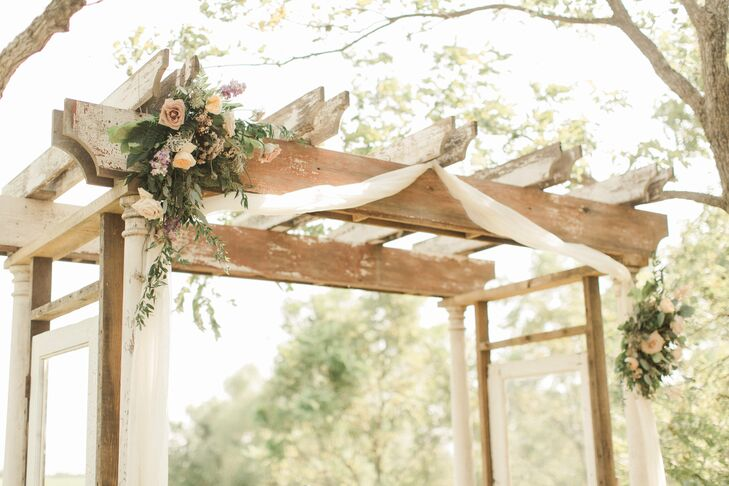 Wood Ladder Wedding Arch Draped in Fabric