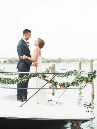 Couple leaving wedding on boat