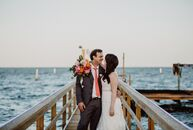When it came to planning their waterfront wedding in Rockport, Texas, bold colors were a must for Ellen Hewitt and Zach Sanders. Shades of bright pink