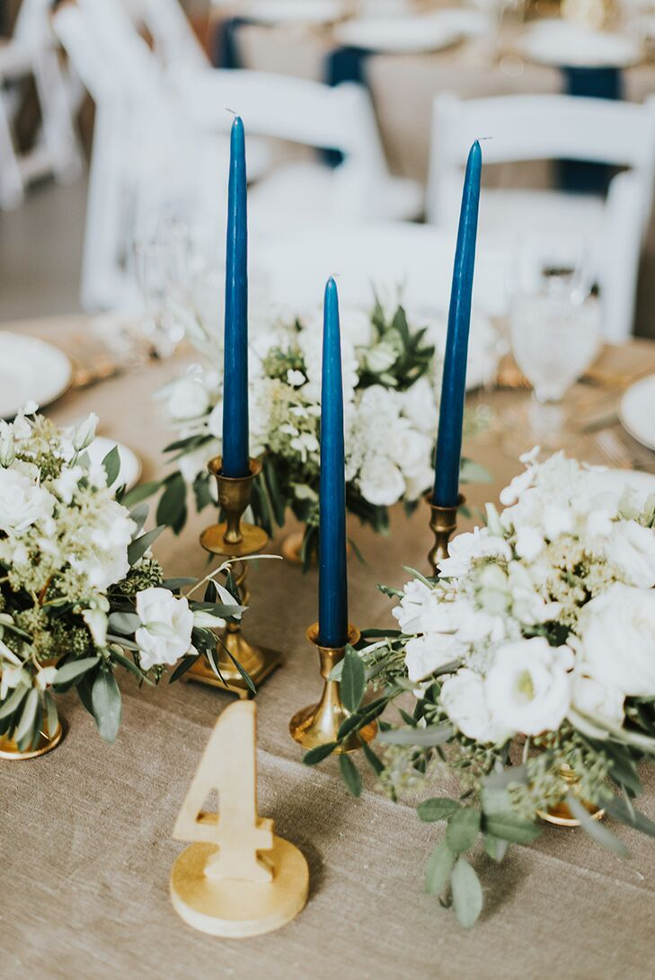 Navy taper candles and gold vintage holders