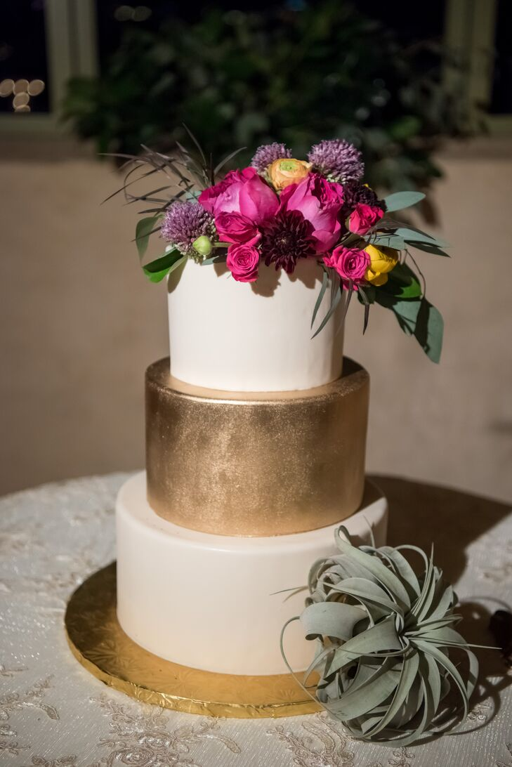 "Las Vegas Custom Cakes crafted Jenna and Brett's three-tier dessert. ""Our cake was ivory for the top and bottom tiers and had a gold middle tier. We only had  florals at the top, to match the florals throughout the wedding,"" Jenna says."