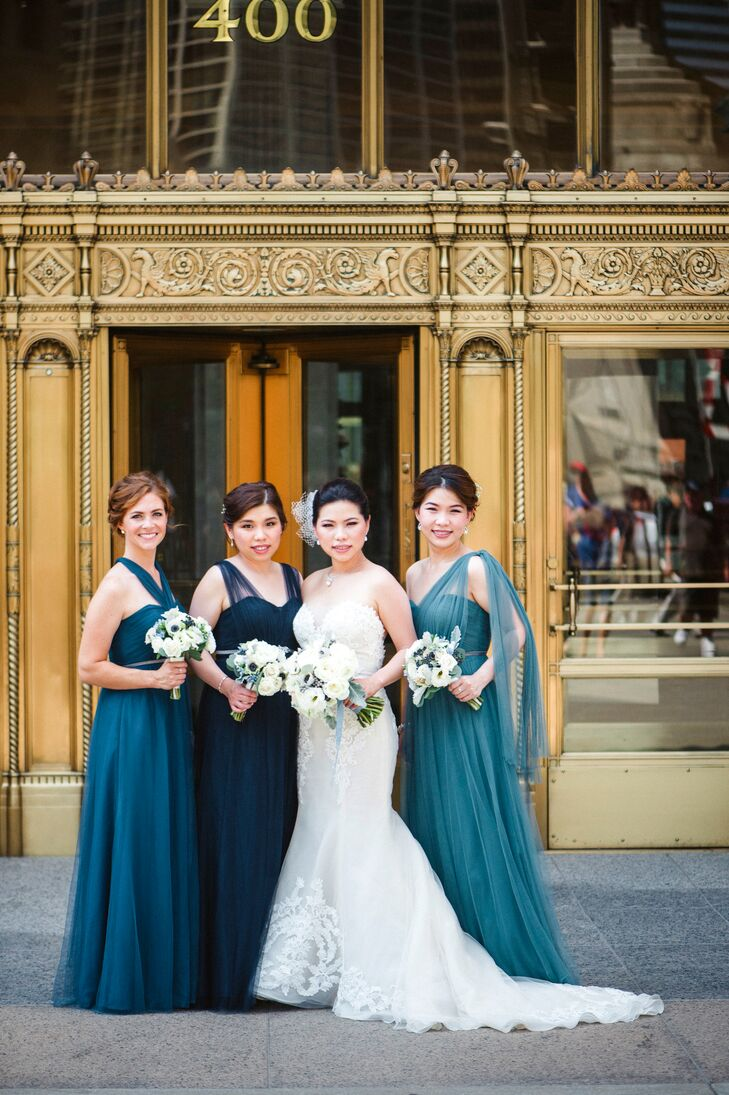 "With two bridesmaids living outside the country, coordinating dress efforts was a little difficult. Lydia bought and shipped her sisters' five dresses in different styles, materials, colors and sizes. They chose a convertible style, Annabelle, by Jenny Yoo. Once she had locked in a dress designer, Lydia picked the three ""loveliest shades of blue"" and asked her bridesmaids to choose from those shades, then purchased matching belts for all three to unify the look."