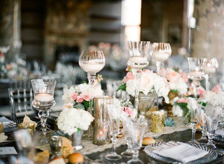 The atmosphere was cozy and inviting, with lace table runners, mercury glass candles, gilded accents and small bouquets of white hydrangeas and pink roses in antiqued vases dotting long wooden farm tables.