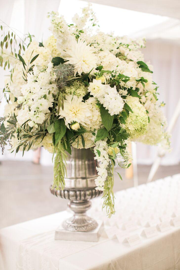 Elegant white floral arrangement in silver urn mightylinksfo