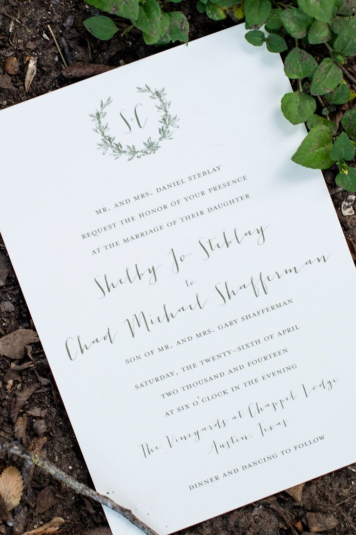 The stationery was simplistic and elegant on white card stock with olive font and a ribbon. The laurel wreath illustration on the stationery matched the lace floral appliques on Shelby's wedding dress.