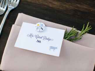 Greige linen reception napkin with animal place card