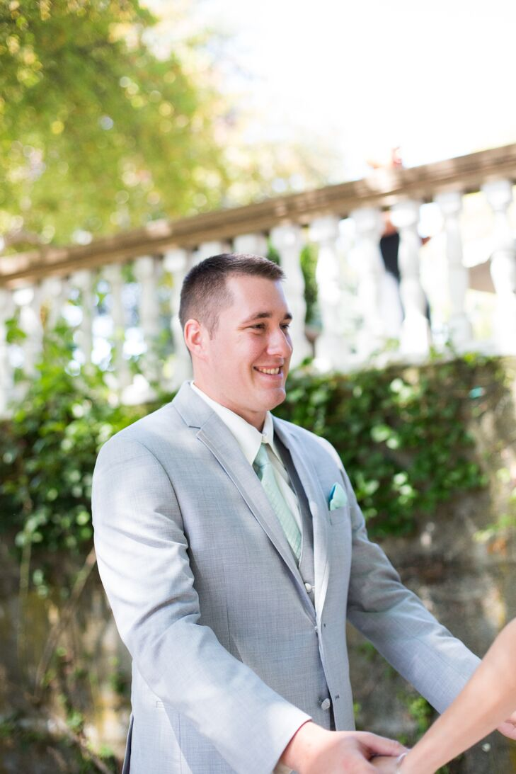 James turned around to see Denise for the first time in her wedding dress, and he looked quite charming himself. He sported a mint green tie with a pocket square to match, tucked into his light gray suit jacket.