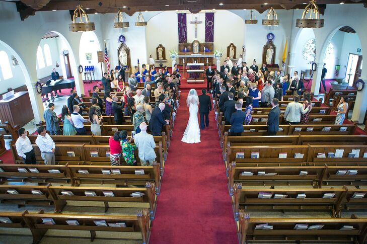 """We wanted to have a Catholic traditional wedding that included mass,"" says Patricia. ""We had our wedding at St. Brendan Church in San Francisco. The church is not too big and accommodated the number of guests well."""