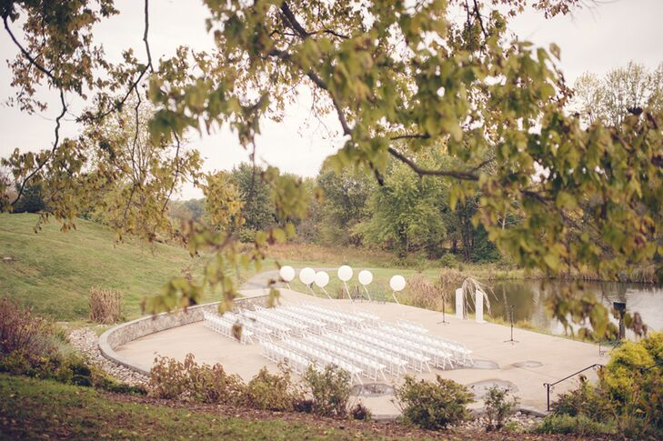 """We chose the location because it fit the number of people we were inviting  as well as had beautiful views of the Potomac, with rolling hills in the background and a barn that was just as beautiful on the inside as it was on the outside,"" says Erin. For their waterfront ceremony, Dogwood Events helped to highlight the venue with rows of white folding chairs,  white balloons floating along the aisle and a white, shabby-chic white wedding arch."
