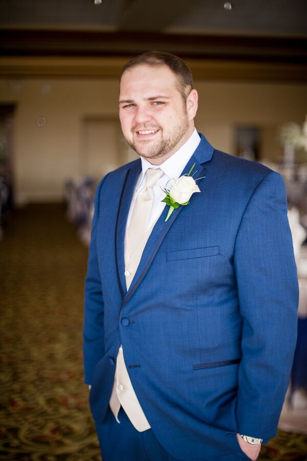 Blue Tuxedo With White Rose Boutonniere