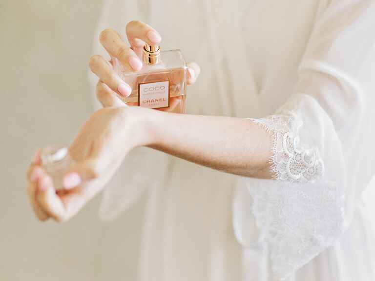 bride spraying chanel perfume