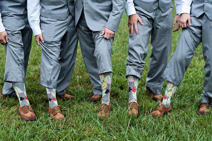 "The groomsmen accessorized their light gray three-piece suits (""Twilight"" by Jean Yves) with peach pink ties, colorful fall leaf socks, and even matching brown wingtip shoes (by Izod)."