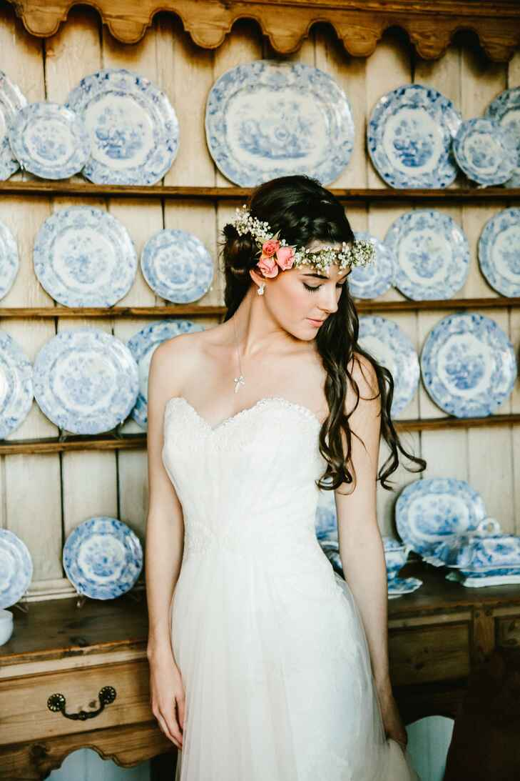 Bride in strapless dress wearing a floral crown
