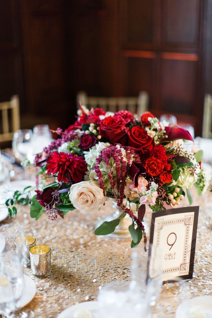 Red and burgundy dahlia ranunculus amaranthus centerpiece