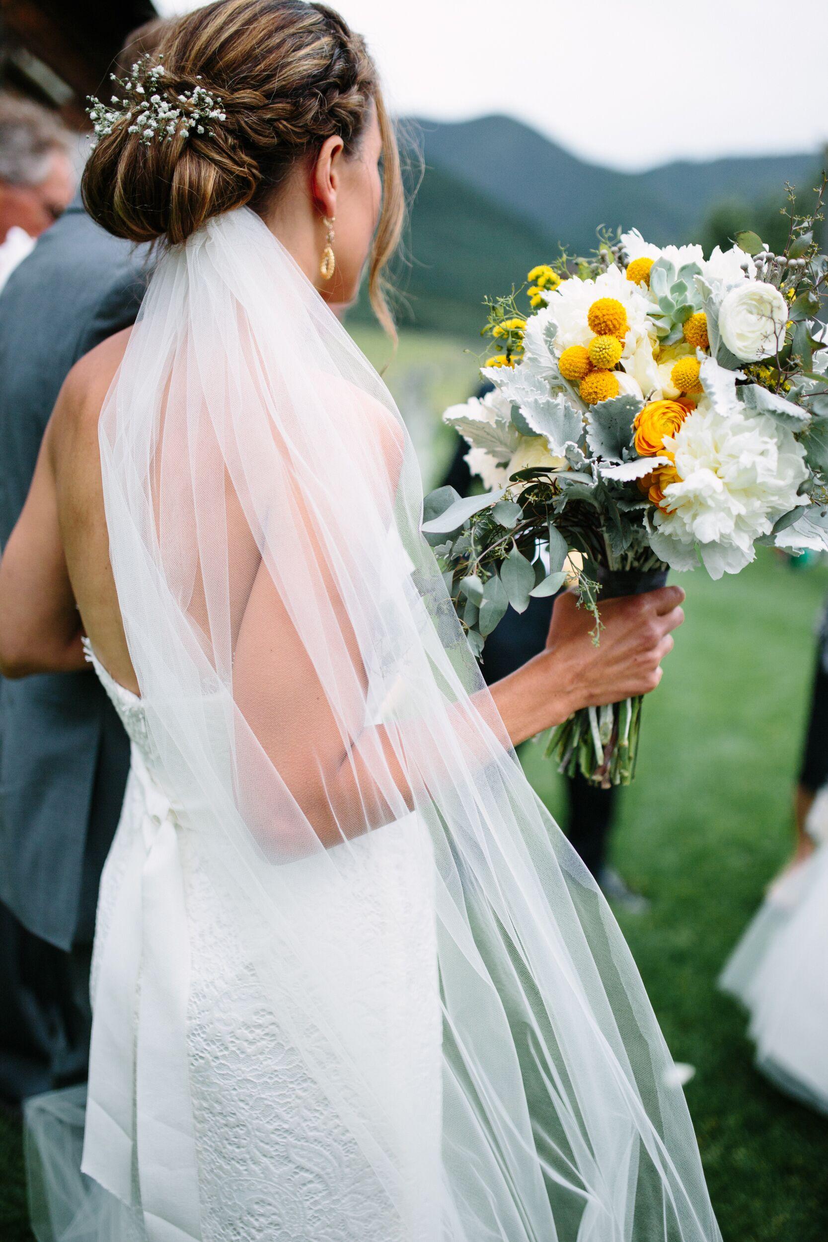 white babys breath decorated bridal updo wedding hairstyle