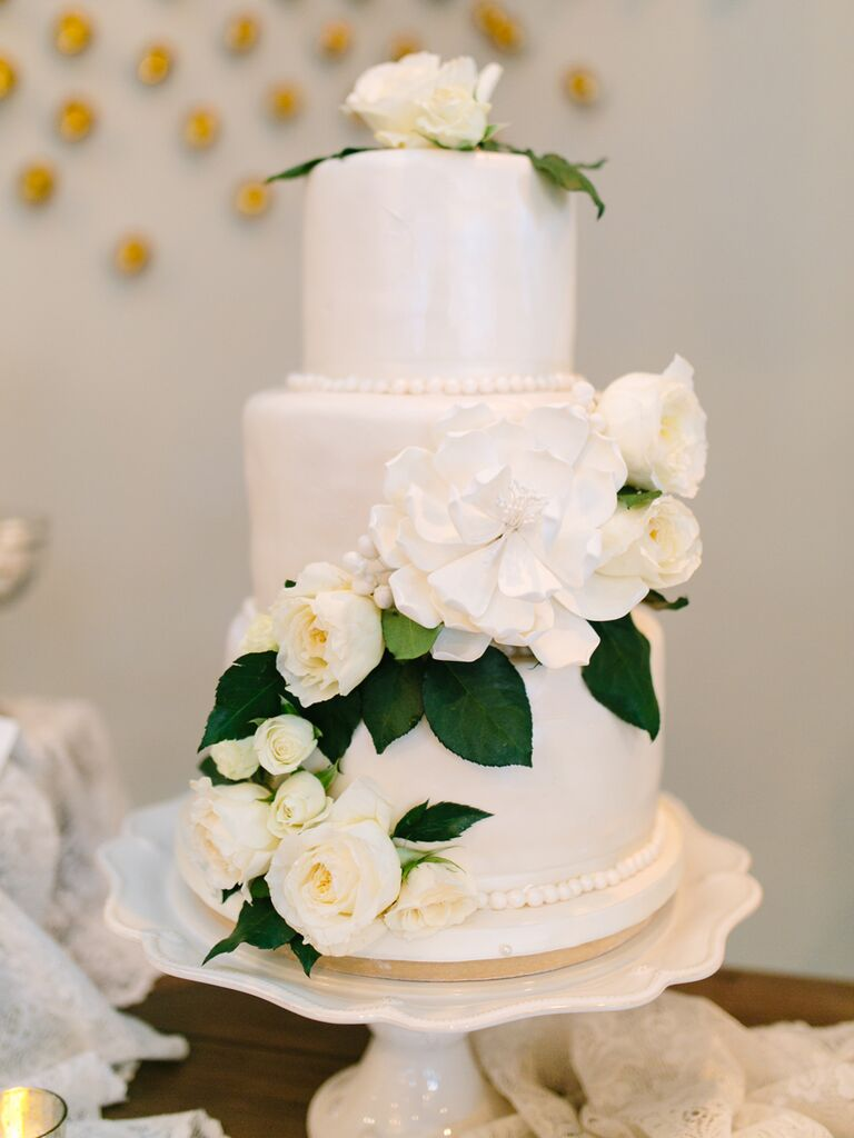 White Wedding Cake With Fresh Roses And A Sugar Flower