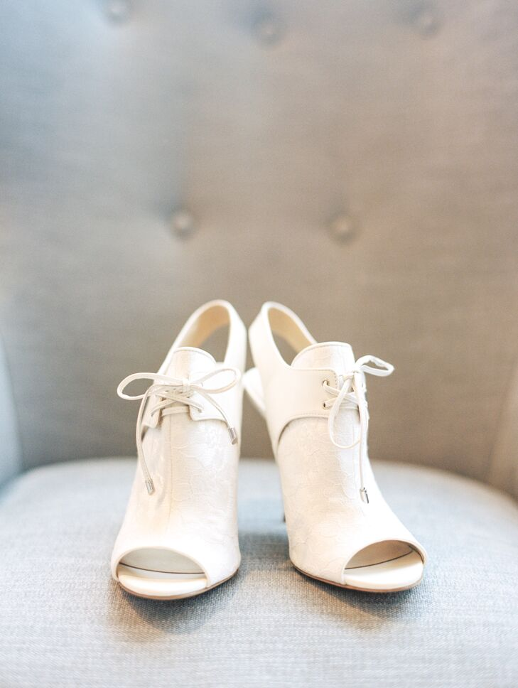 """Instead of opting for a classic pump or strappy sandal, I found a pair of peep toe leather and lace booties for a less expected look,"" says Nathalie. The ivory booties complimented her retro, vintage style of dress and theme."