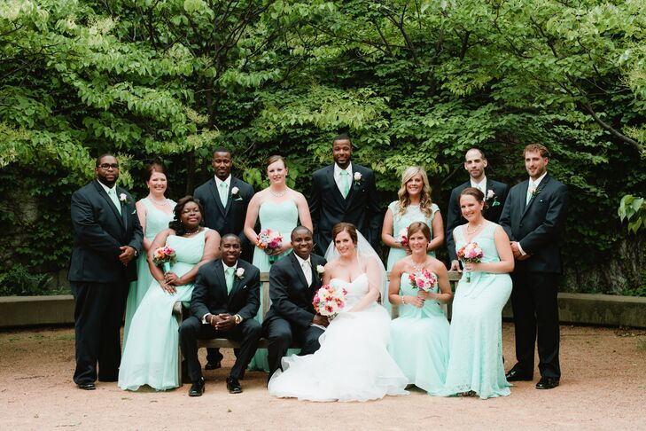 Ali had six bridesmaids stand with her. They all wore mint Mori Lee gowns, but in different styles and textures. The six  groomsmen donned navy Michael Kors suits with mint-colored ties to match the bridesmaid dresses.