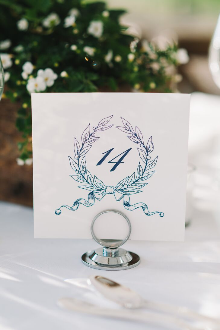 Anna drew a custom wreath logo that was then incorporated throughout the couple's entire invitation suite – including these elegant table numbers.