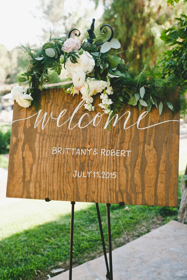 Wooden signs with hand-painted calligraphy decorated the reception space.
