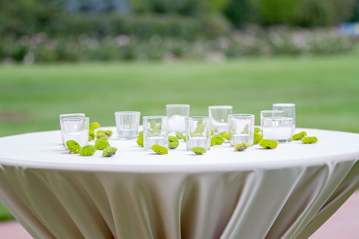 The tables at Ashley and Roshan's cocktail hour were topped with votives and green chrysanthemums.