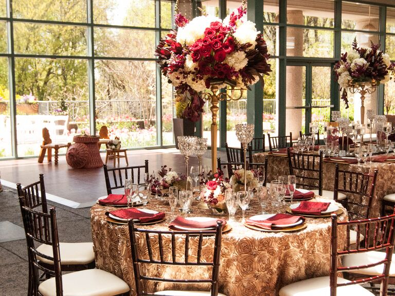Red And Ivory Centerpiece On Gold Reception Tables