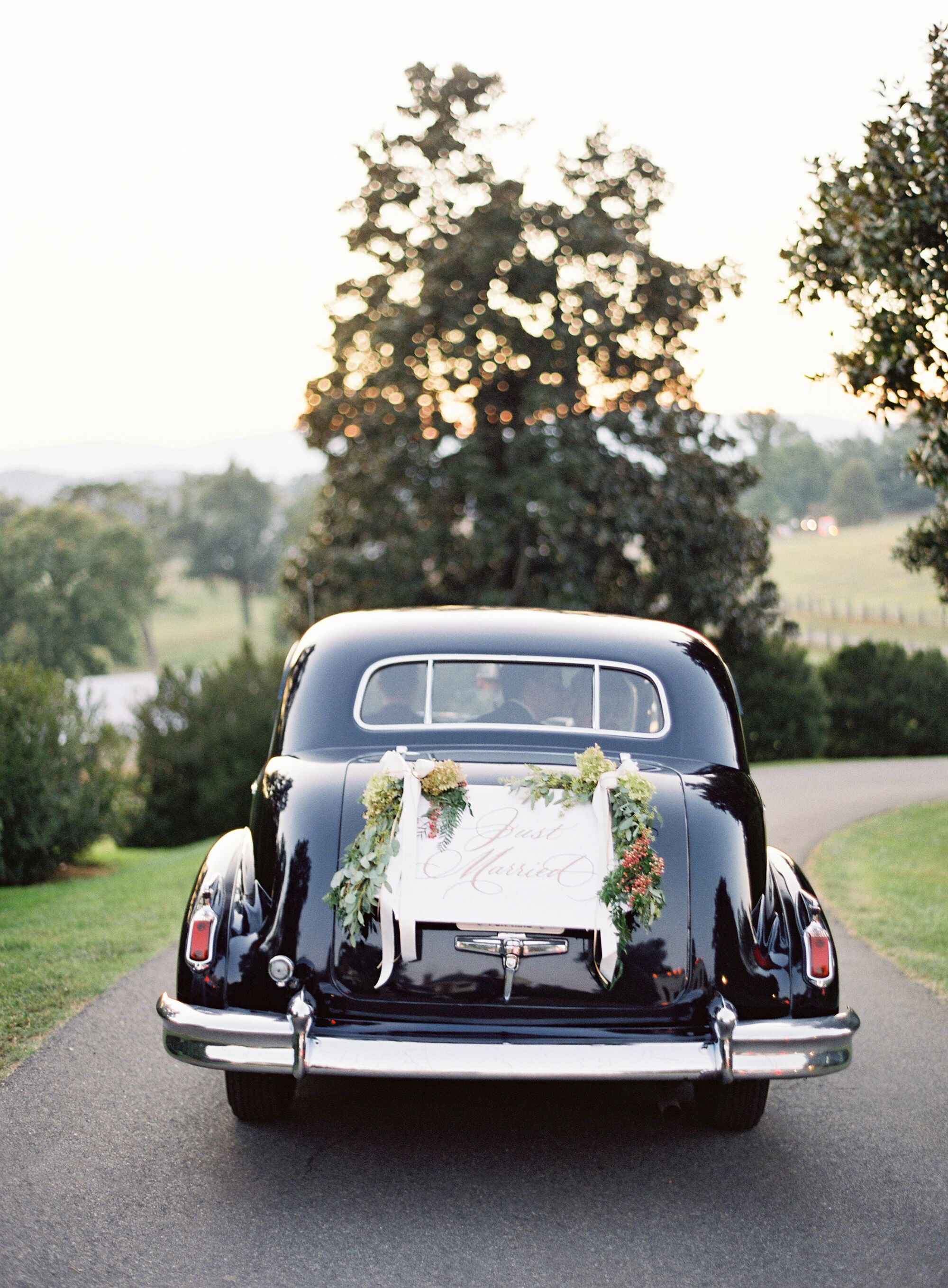 the happy couple in vintage car leaving reception with ...  Vintage Just Married