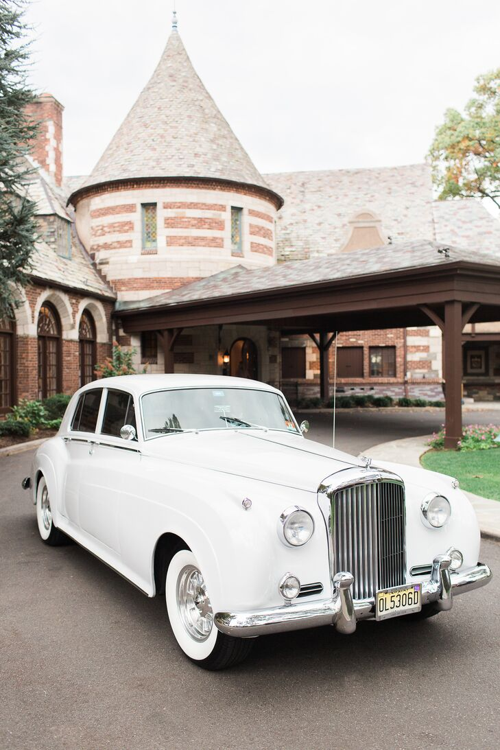 Talk about timeless: Even their exit car matched the couple's color scheme. After they exchanged vows, Mariel and Colin made their way to a classic white Rolls-Royce. The ride gave them a few moments alone before reaching the reception at Ridgewood Country Club in Paramus, New Jersey.