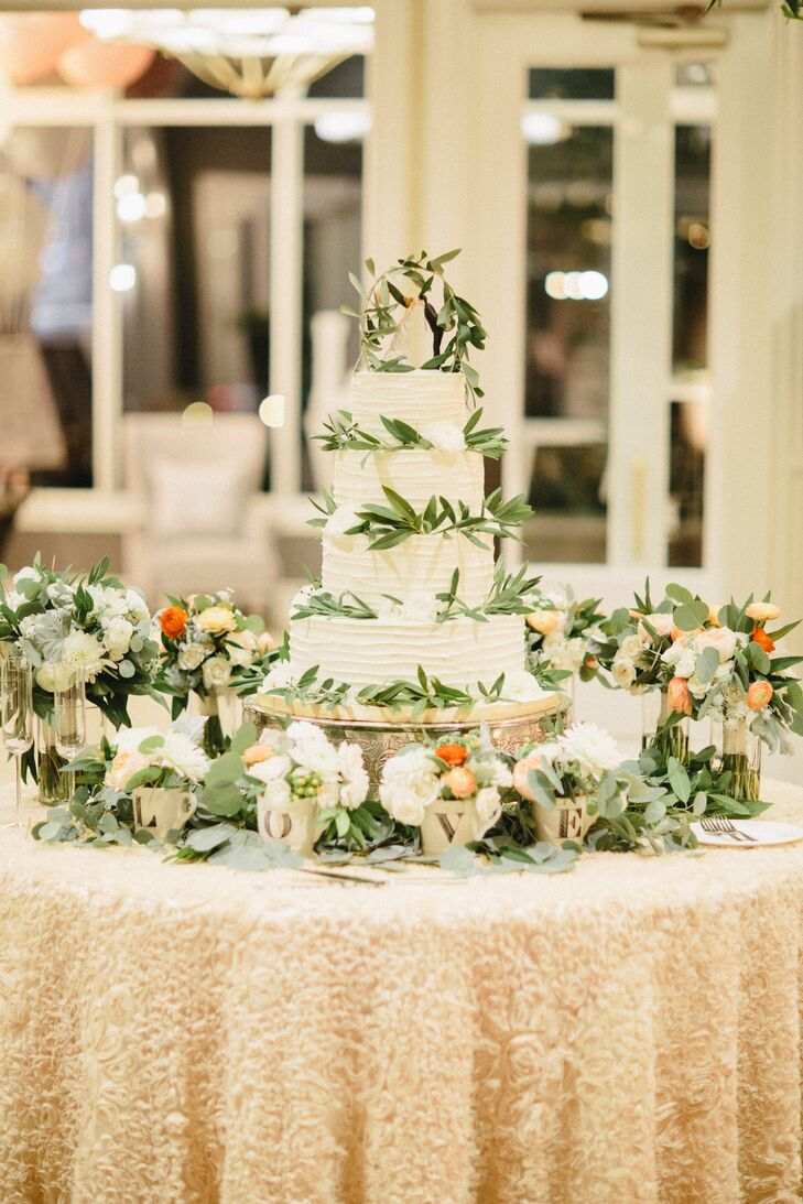 simple white wedding cake with greenery textured ivory wedding cake with greenery branches 20122