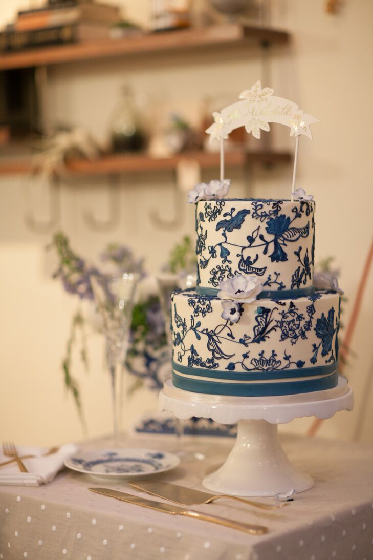 Lauren and Taylor's salted caramel wedding cake mimicked the blue and white ginger jar pattern and was topped with a gold painted banner with their last name from Etsy.
