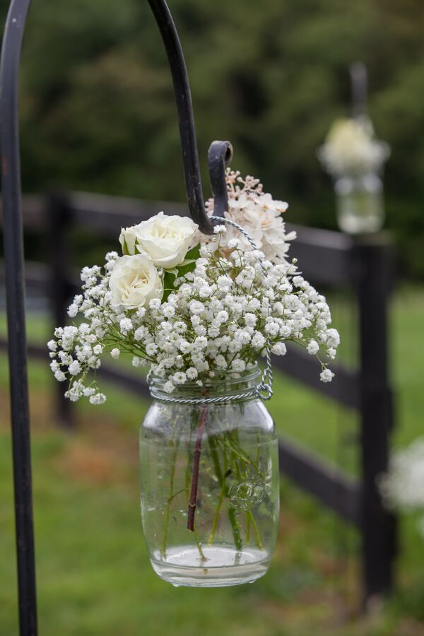 White Rose And Baby S Breath Centerpiece