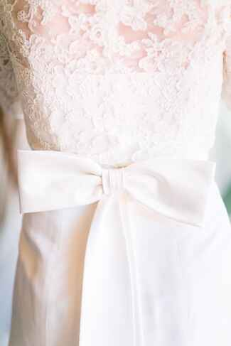 Lace wedding dress with bow