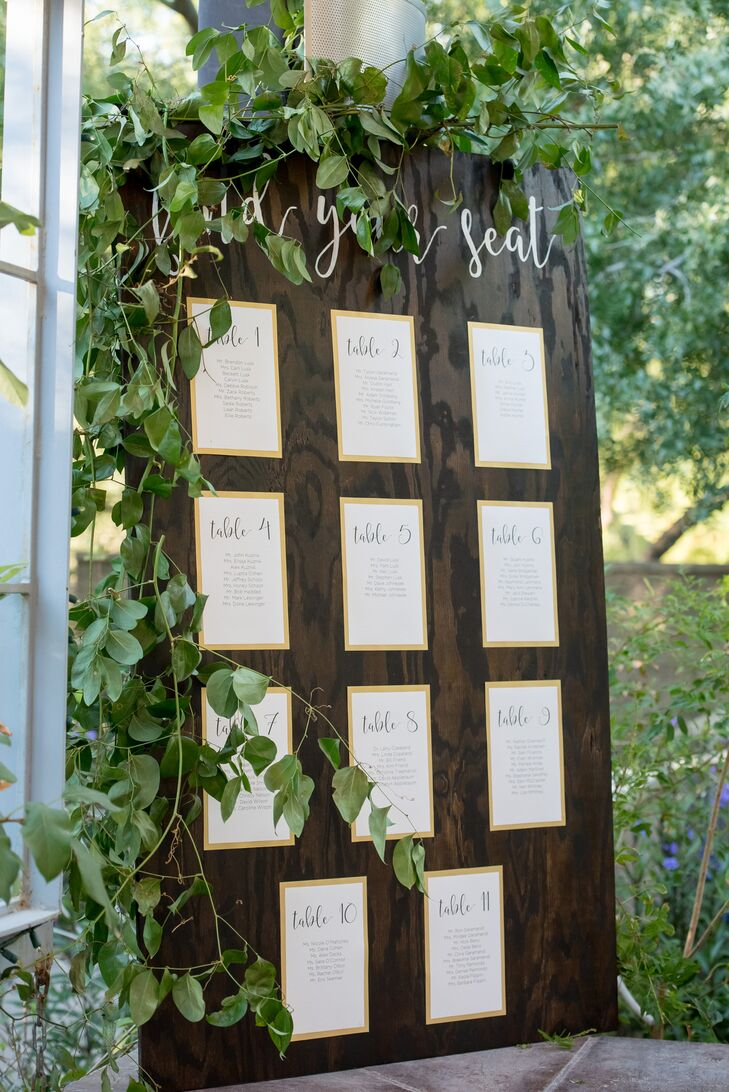"In keeping with the natural vibe at the Springs Preserve in Las Vegas, Nevada, after the ceremony guests found their names on lists posted to a large wooden board. ""I made a large wooden board and stained it a darker color to match the wooden sign with our names on it,"" Jenna says. ""It had at the top 'Find your seat' written in calligraphy as well."""