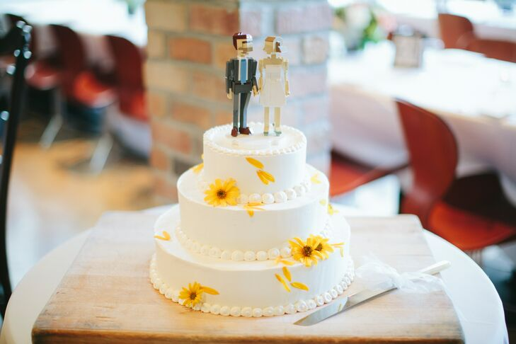 A chocolate, buttermilk cake made with vanilla buttercream and raspberries was served and topped with a personalized cake topper of the couple.