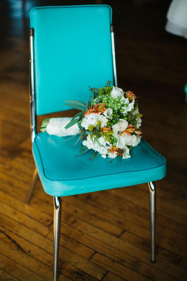 Fasan Florist created the bride's colorful bouquet that included roses and calla lilies.