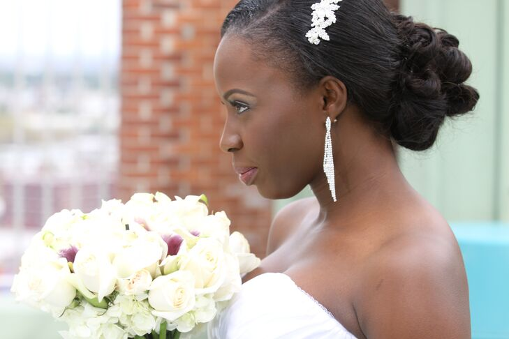 Bridal Updo with White Hair Accessory and Dangle Earrings