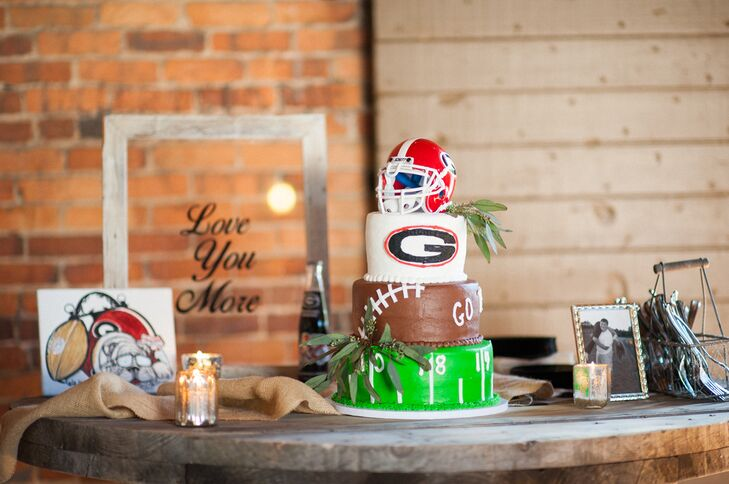 Russ chose a Georgia Bulldogs-themed three-tier chocolate cake for his groom's cake. The first tier was designed like a football field, and the third tier was a University of Georgia football helmet topper.