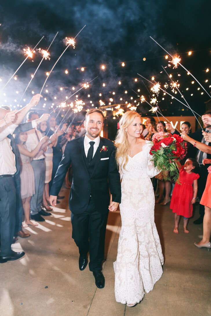 """We felt on top of the world as we walked under that sparkling canopy, seeing all the lit-up faces of the people we love,"" Carlie says of her and Nate's grand exit."
