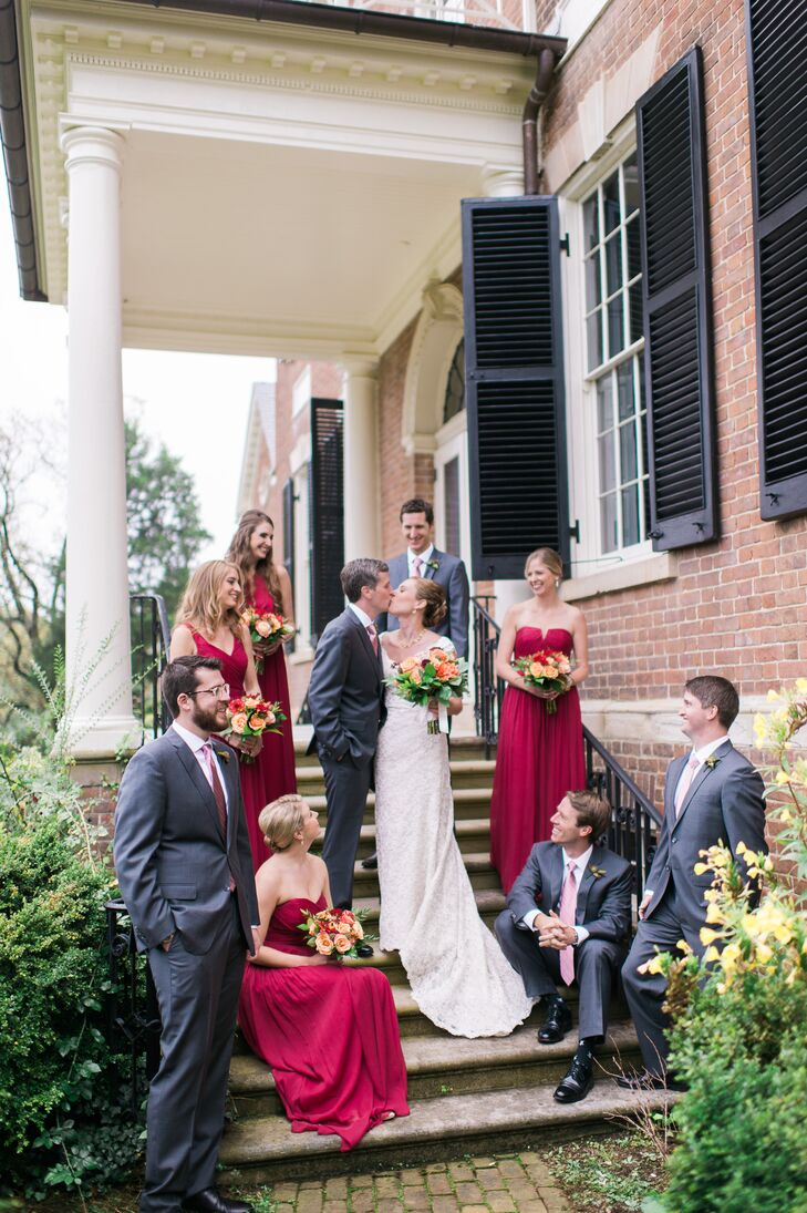 Christine and John stood on the steps of Woodlawn in Alexandria, Virginia, surrounded by their wedding party dressed in floor-length burgundy dresses and charcoal gray suits.